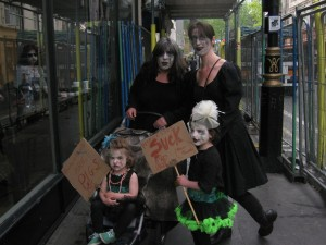 A family of zombies just outside Starbucks