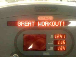 Photo of the screen on an exercise bike. It reads GREAT WORKOUT! in red LCD letters. Photo by Flickr user Tim Dorr, shared under Creative Commons.