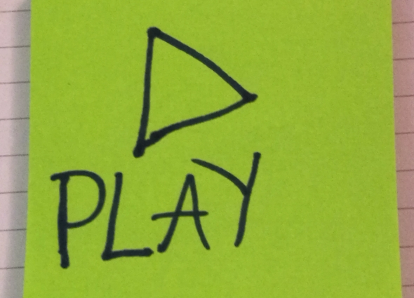 post-it note with 'play' written on it